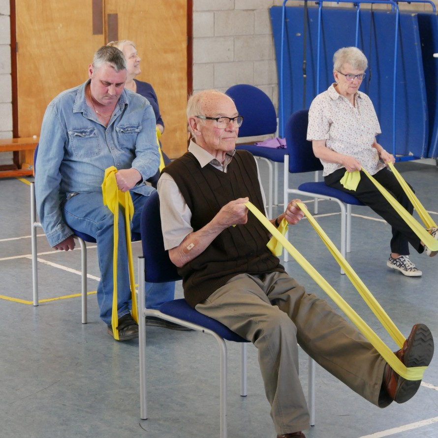 older adults doing chair based exercise